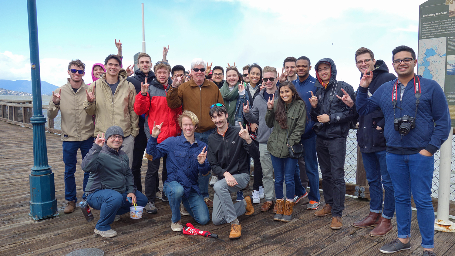 Group of students and faculty on a dock in California.