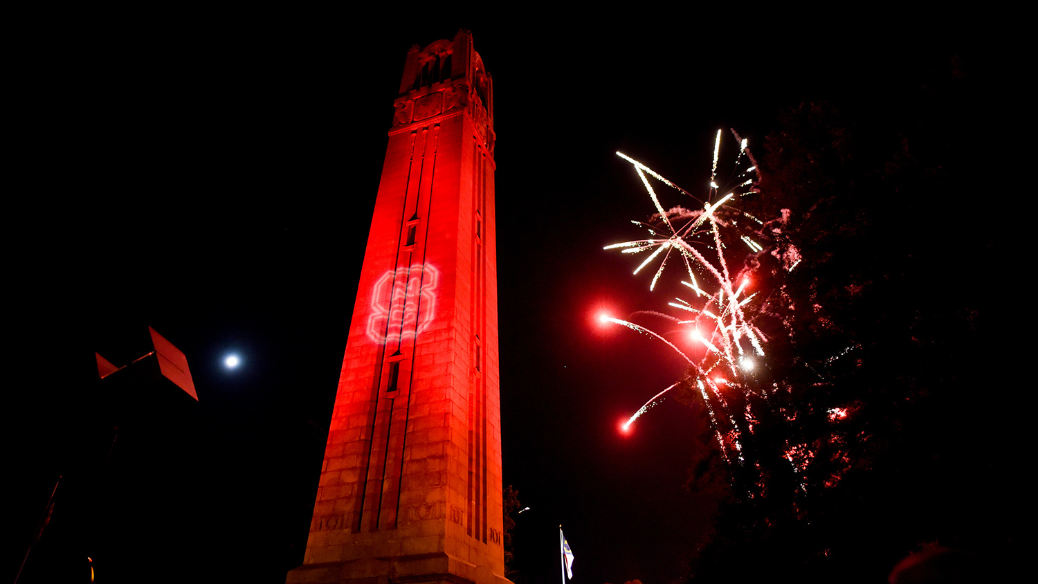 NC State year in review 2018 — The Belltower with fireworks at Packapalooza