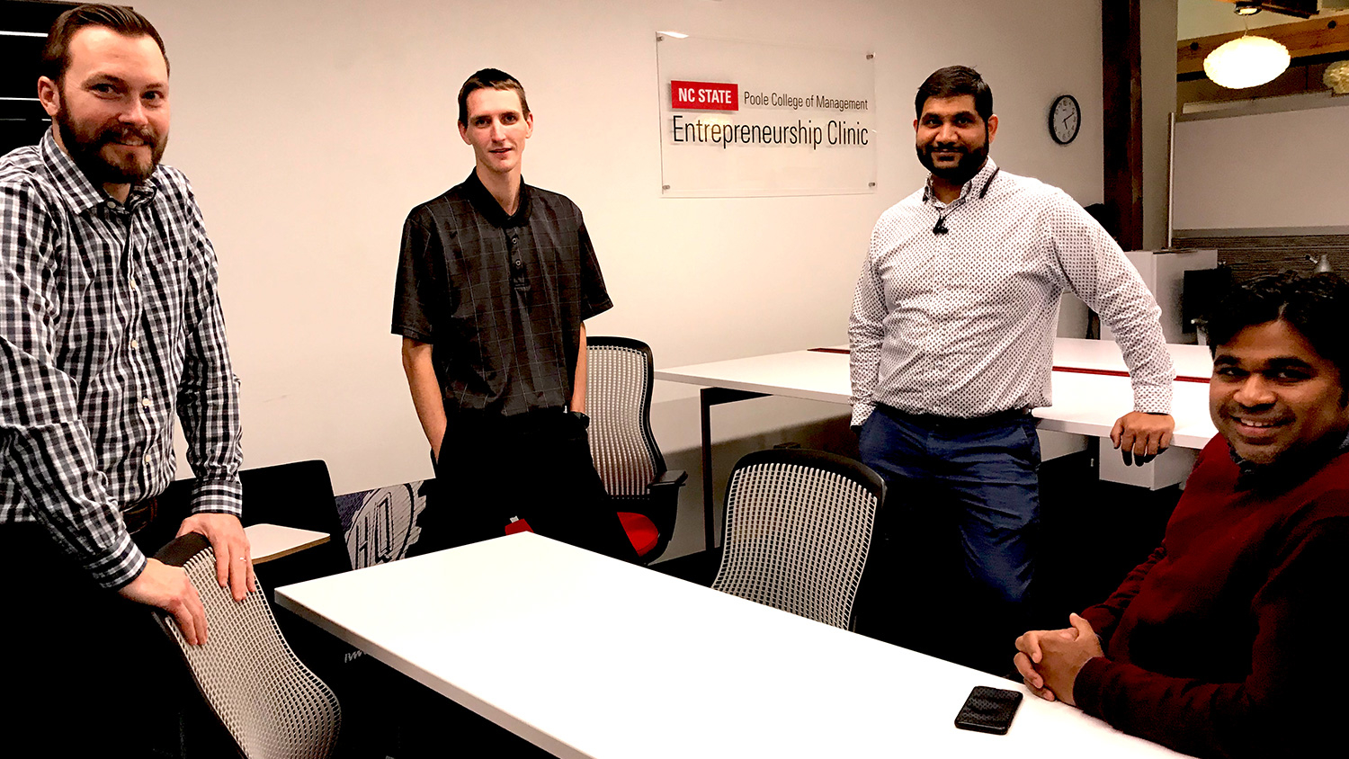 MBA team members meeting at the NC State Entrepreneurship Clinic, left to right: Cody Shipman, Taylor Utecht, Shyam Ram, and Krupa Stephen Gadde