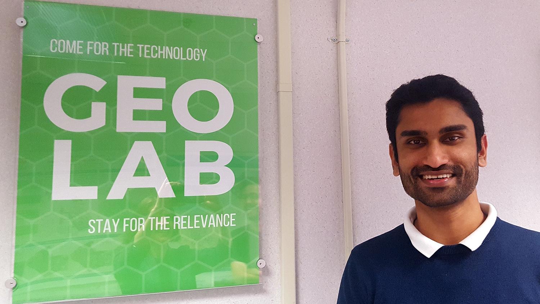 Vishnu Mahesh Vivek Nanda stands next to the GeoLab sign