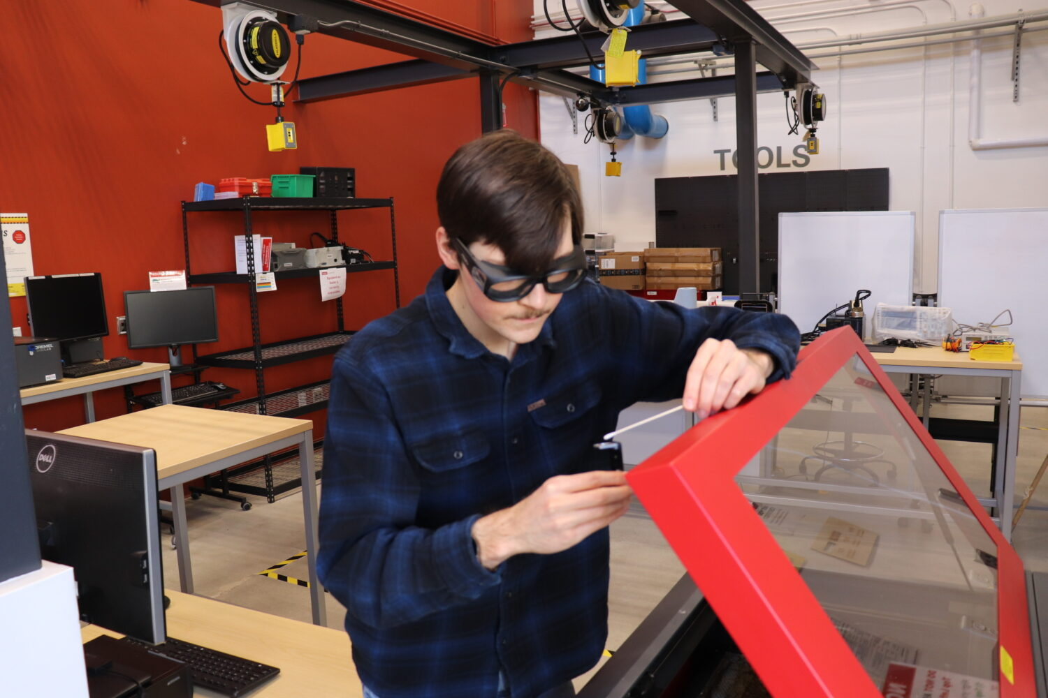 A picture of Neill working in the workshop